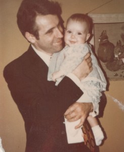 My dad holding me as a baby. Such a happy photo.